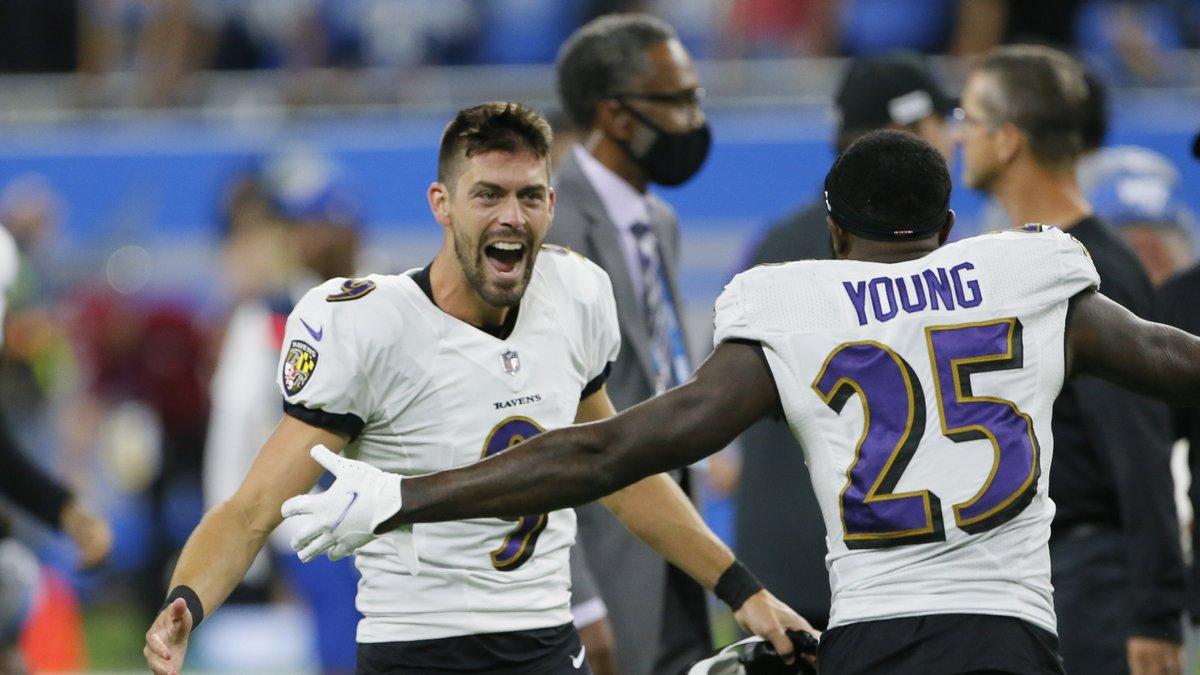 Baltimore Ravens kicker Justin Tucker (9) celebrates with Tavon Young (25) after kicking a...
