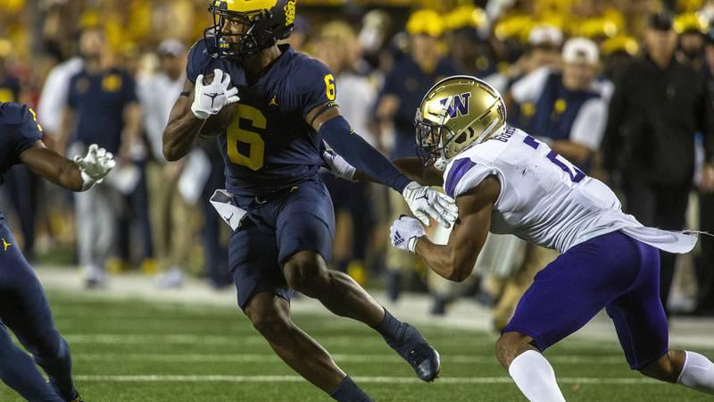 Michigan wide receiver Cornelius Johnson (6) rushes away from Washington defensive back Kyler...