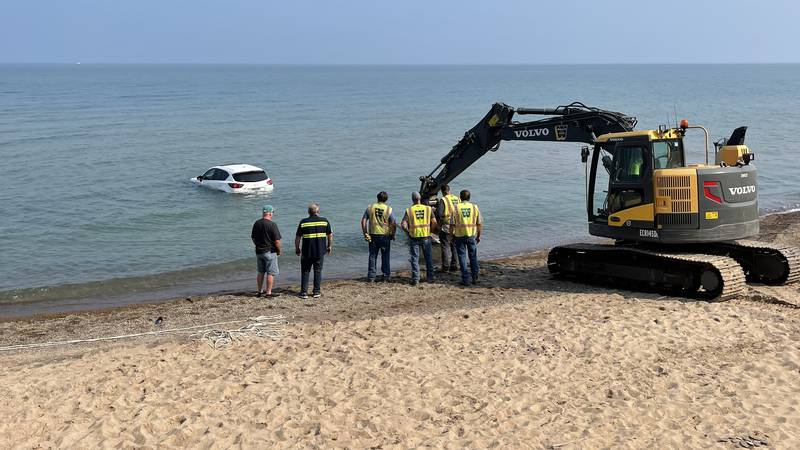 First responders found the car partially submerged and drifting further into the lake.